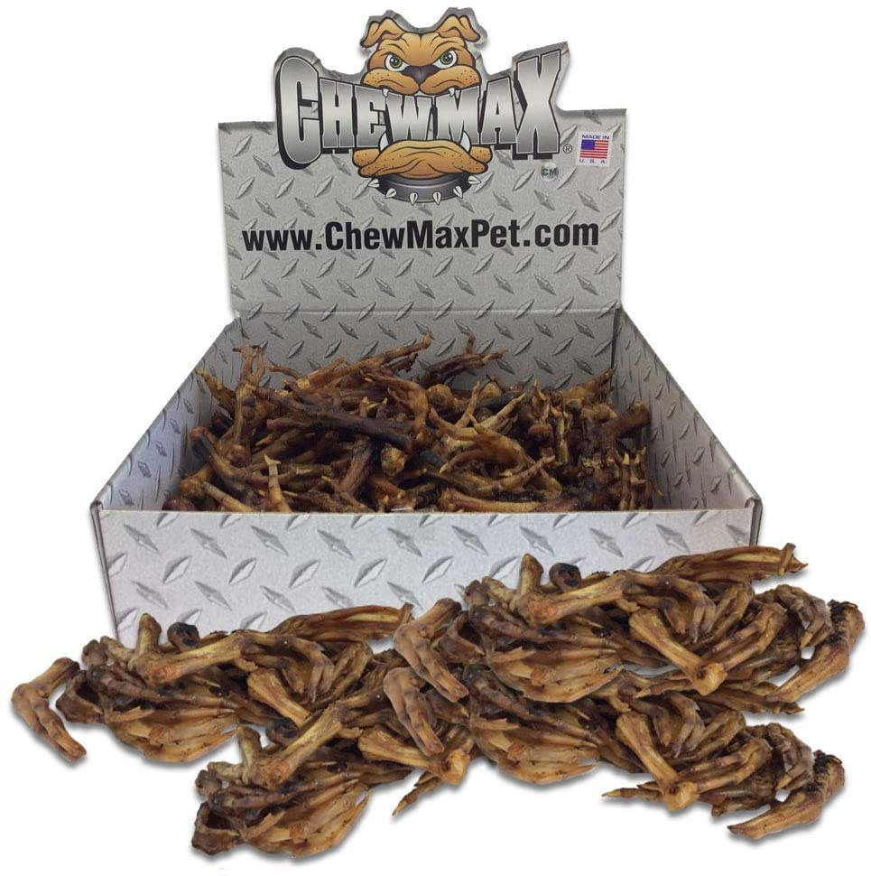 An open-top box full of duck feet with some piled in front